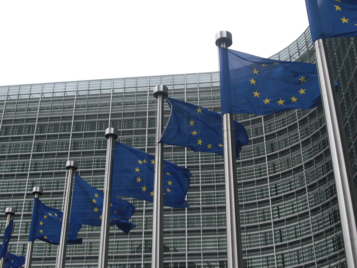 Flags in front of the European Commission building in Brussels. (Credit: Sébastien Bertrand/Wikipedia.)